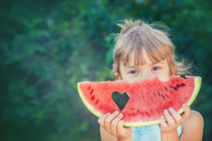A child eats watermelon. Selective focus. nature.