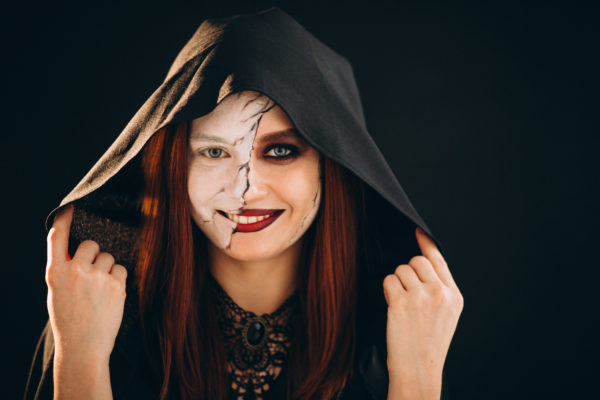 Woman in a halloween costume in studio