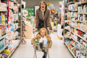 Mother with daughter at a grocery store