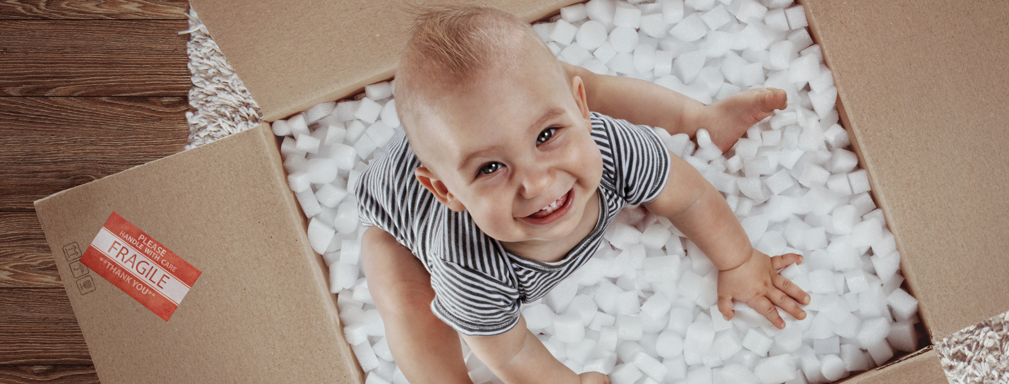 Baby Safety Month - Baby in Box with Packing Peanuts